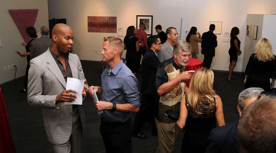 Guests chat while viewing the works Photo: Dave Rossman, For The Houston Chronicle