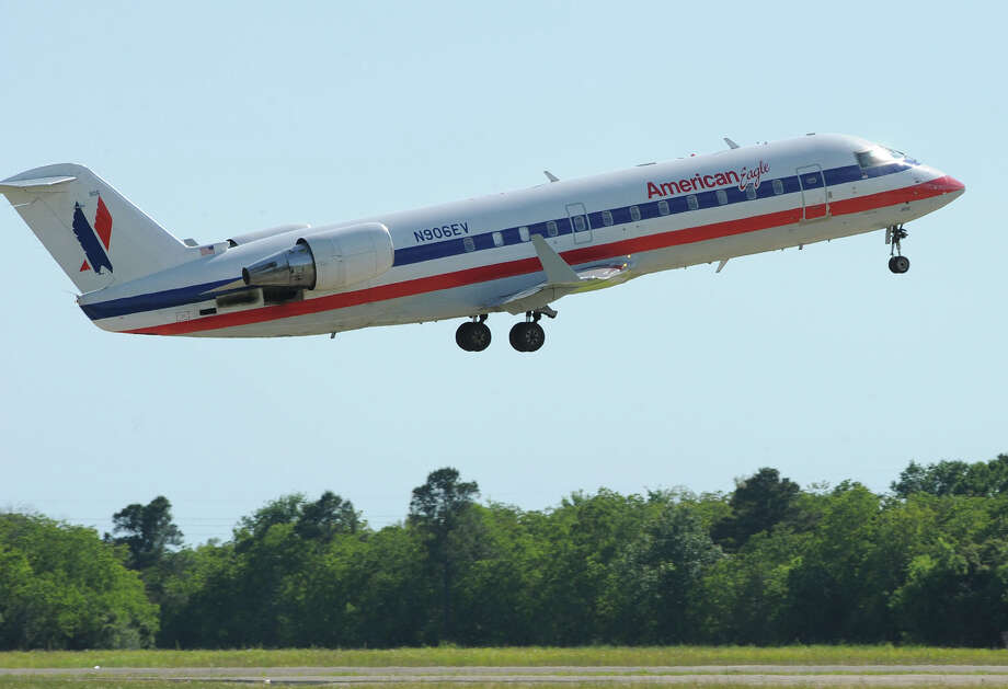 An American Airline jet takes off at the Jack Brooks Regional Airport on Monday. The Southeast Texas Coalition for Air Service approved Monday American Airline's $310,000 request designed to supplement the airline's expenses not covered by ticket sales.  Photo taken Monday, May 06, 2013 Guiseppe Barranco/The Enterprise Photo: Guiseppe Barranco, STAFF PHOTOGRAPHER / The Beaumont Enterprise