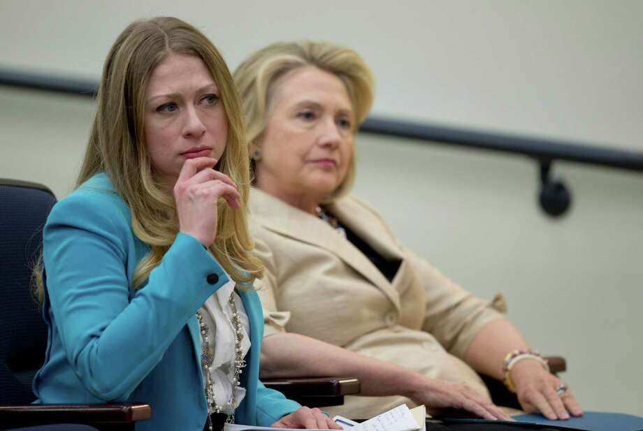 "This Sept. 9, 2013 photo, former Secretary of State Hillary Rodham Clinton sits with her daughter Chelsea Clinton before she speaks about Syria in the South Court Auditorium on the White House Complex in Washington.   Hillary Rodham Clinton may or may not run for president, but Chelsea is hoping to bestow another title on her: grandmother. The daughter of Hillary and former president Bill Clinton tells Glamour magazine that 2014 will be ""the Year of the Baby."" Chelsea Clinton says in the November issue that she and husband Marc Mezvinsky are hoping to start a family.  She adds that her mother asks about baby plans ""every single day."" (AP Photo/Carolyn Kaster) ORG XMIT: NY112 Photo: Carolyn Kaster / AP"