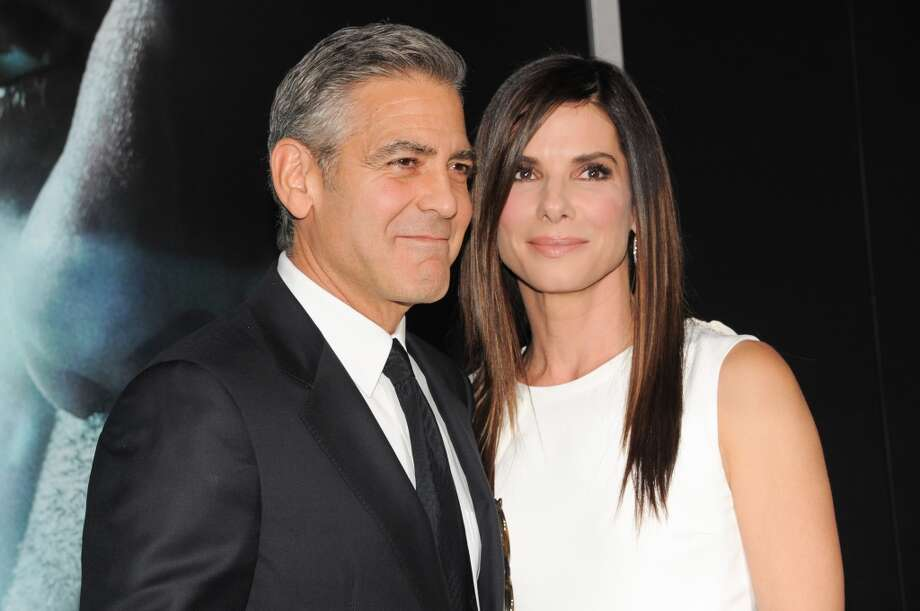 "Actors George Clooney and Sandra Bullock attend the premiere of ""Gravity"" at the AMC Lincoln Square Theaters on Tuesday, Oct. 1, 2013, in New York. (Photo by Evan Agostini/Invision/AP) Photo: Evan Agostini, Associated Press"