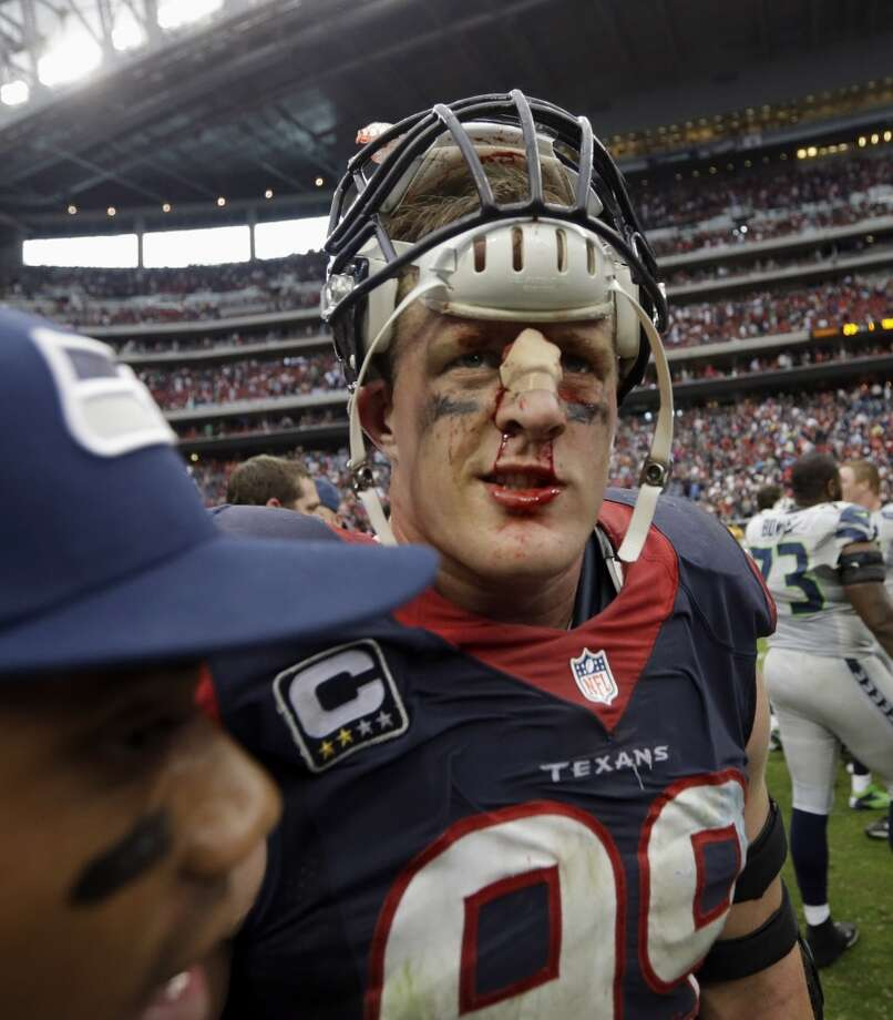 Houston Texans defensive end J.J. Watt (99) talks with Seattle Seahawks quarterback Russell Wilson, left, after an overtime of an NFL football game Sunday, Sept. 29, 2013, in Houston. Seattle won 23-20. (AP Photo/David J. Phillip) Photo: David J. Phillip, Associated Press