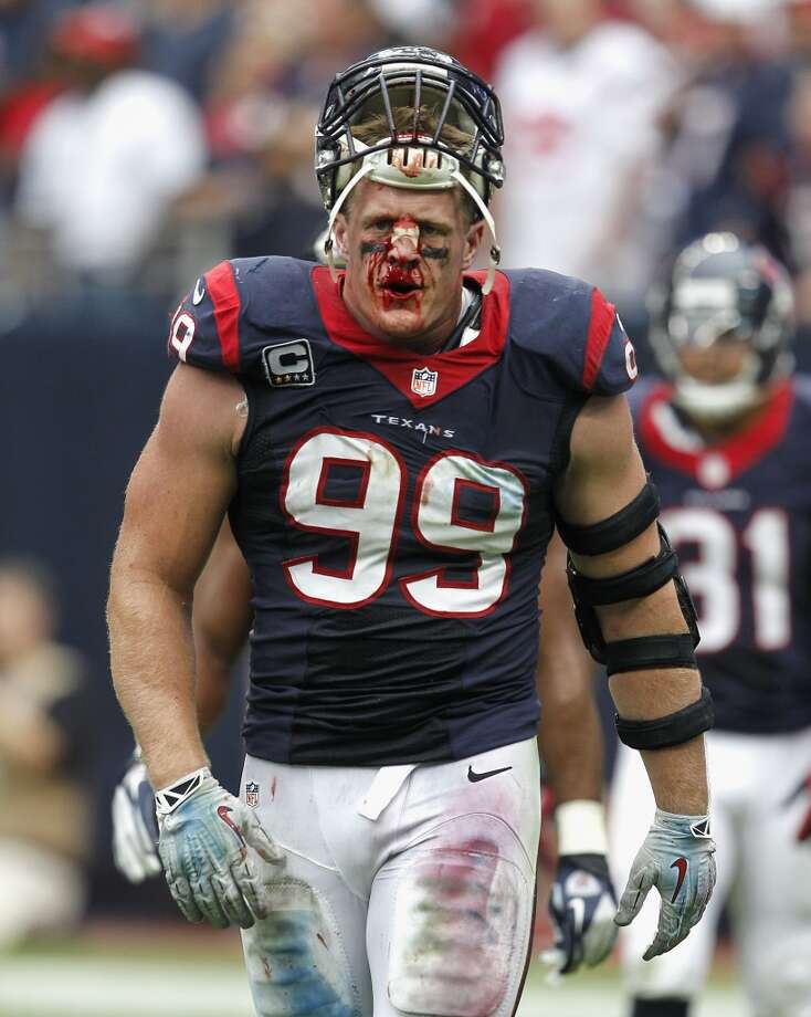 HOUSTON, TX - SEPTEMBER 29:  J.J. Watt #99 of the Houston Texans comes off the field after suffering a cut to the bridge of his nose against the Seattle Seahawks at Reliant Stadium on September 29, 2013 in Houston, Texas.  (Photo by Bob Levey/Getty Images) Photo: Bob Levey, Getty Images