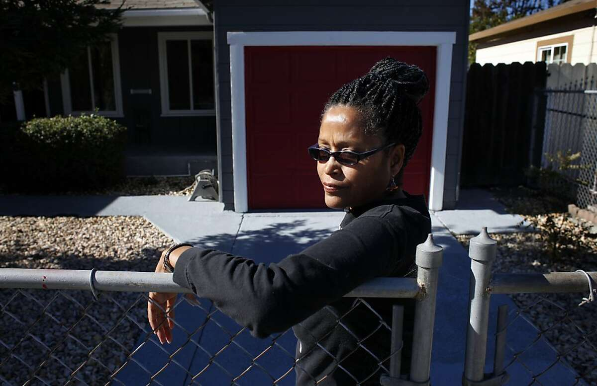 """Nehanda Nimara stands in front of her home, Wednesday September 25, 2013, which is less than a mile from where the crematorium in Emeryville is be moved in Oakland, Calif. """" Here is Oakland, if I wanted to start a community garden I would have to spend $3,000 on a Conditional Use Permit and have lots of restrictions, but if they want to put up a Walmart size crematorium, all they have to do is move in and start burning bodies,"""" said Nimara."""