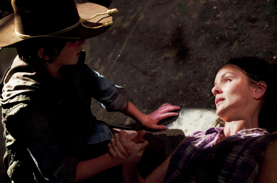 It was bad enough that she had to give birth without the benefit of an epidural in a zombie-filled prison. But then Lori's labor went poorly and she had to have an emergency c-section which she knew would kill her, leaving her  dependent on her young son Carl to kill her before she turned into a walker in one of the most upsetting episodes of 'The Walking Dead.' Photo: Gene Page/AMC