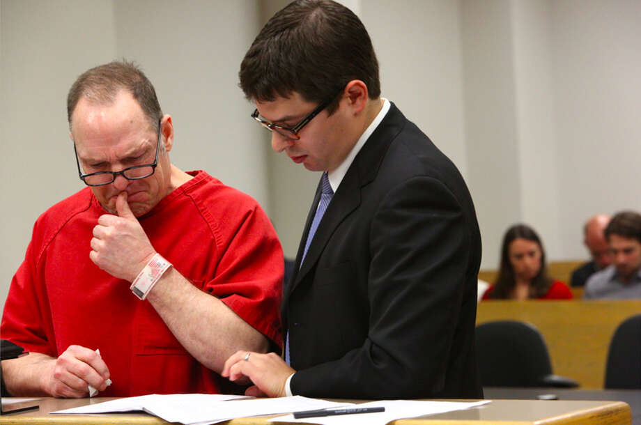 Mark Mullan, left, pleads guilty to charges after killing Judy and Dennis Schulte and seriously injuring Karina Ulriksen-Schulte and newborn baby Elias Schulte while driving drunk. At his side is defense attorney Jesse Dubow. Photographed on Thursday, October 3, 2013 at the King County Courthouse in Seattle. Photo: JOSHUA TRUJILLO, SEATTLEPI.COM / SEATTLEPI.COM