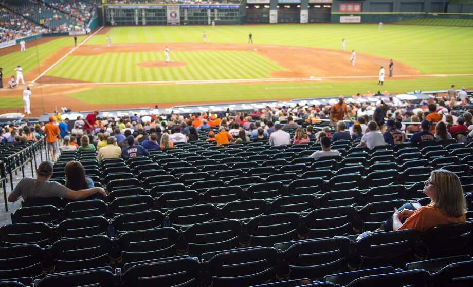 This woman sat through more dreadful Astros losses this season than the Texans will put up in two decades because she is a true fan. There should never be an empty seat in Reliant Stadium. Ever. Photo: Houston Chronicle File Photo