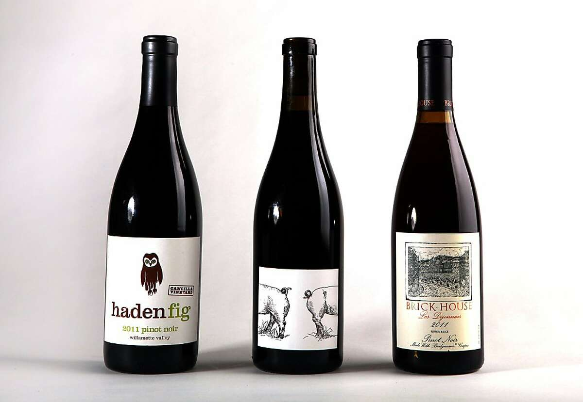 Three Oregon Pinot Noir--2011 Haden Fig (left), 2011 Big Table Farm (middle), and 2011 Brick House Les Dijonnais (right) photographed in San Francisco, California, on Wednesday, September 25, 2013.