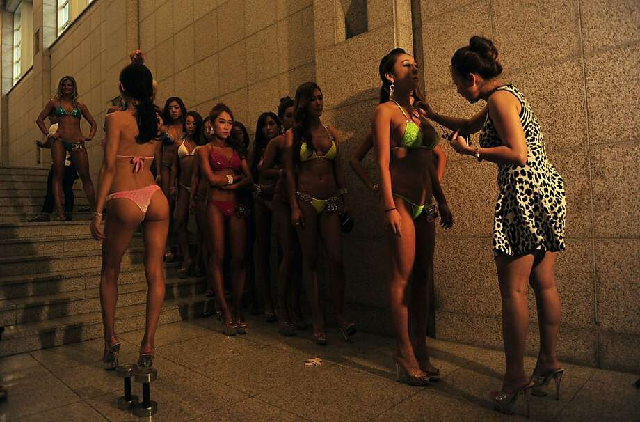 Bodybuilders in stiletto heels line up for some sort of last-minute preparation before taking the stage for the Muscle Mania Fitness Korea Competition in Seoul. Photo: Truth Leem, AFP/Getty Images