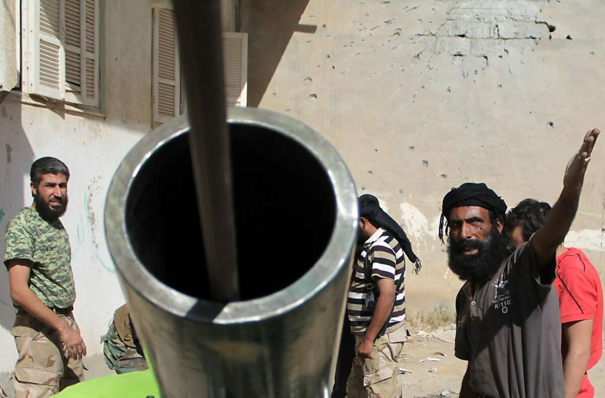 Syrian rebels well-prepared for the War of 1812 to break out again: In Deir Ezzor, Syria, members of the Jund al-Rahman Brigade (Soldiers of the Merciful) load a homemade cannon pointing at government forces with a ramrod.