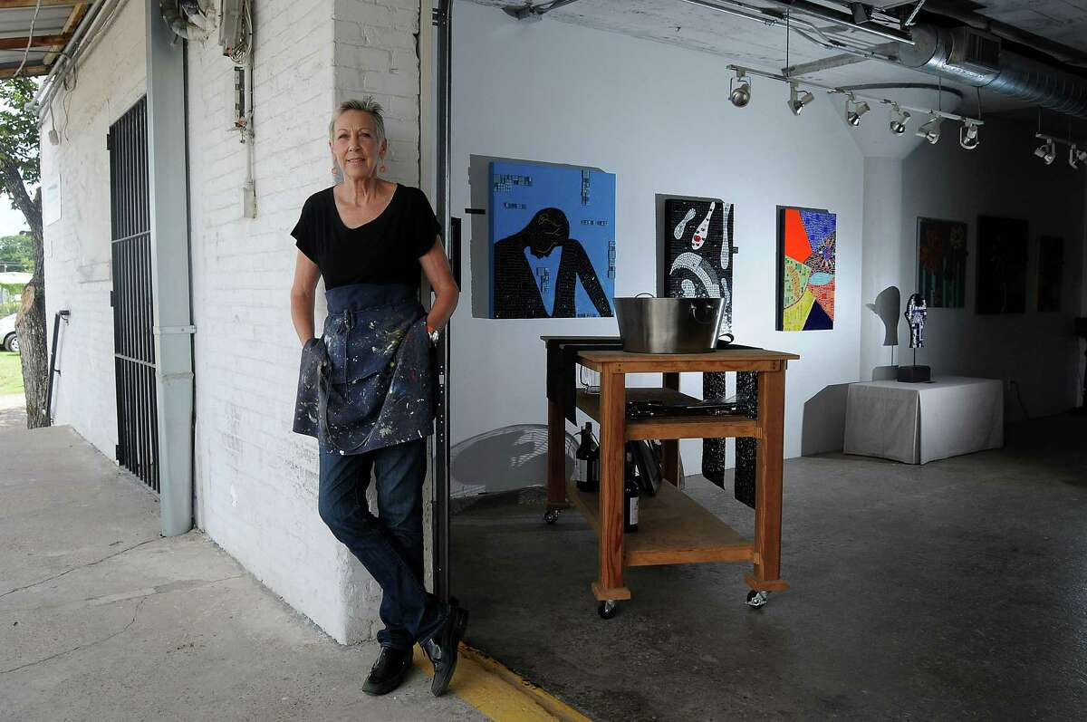 Artist Chris Silkwood stands by her space at the Winter Street Studios Tuesday Oct. 01,2013.(Dave Rossman photo)