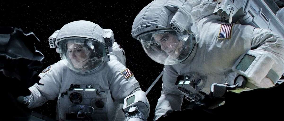 """Sandra Bullock and George Clooney star in """"Gravity."""" (Warner Bros. Pictures/MCT)"""
