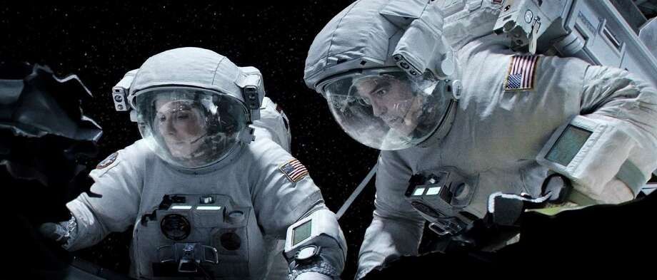 "Sandra Bullock and George Clooney star in ""Gravity."" (Warner Bros. Pictures/MCT) Photo: Handout, HO / MCT"