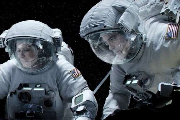 "Sandra Bullock and George Clooney star in ""Gravity."" (Warner Bros. Pictures/MCT)"