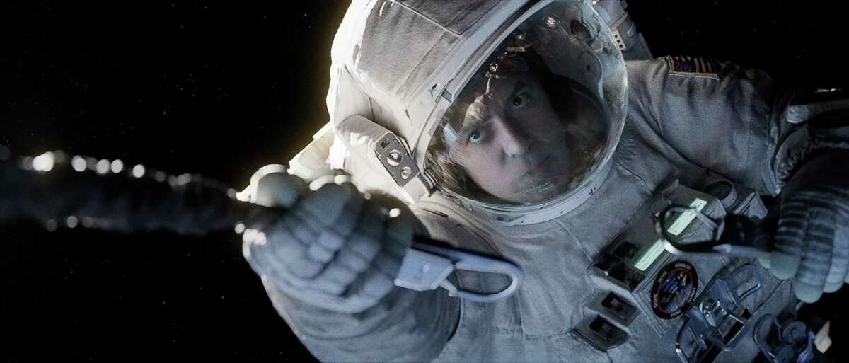 """This film image released by Warner Bros. Pictures shows George Clooney in a scene from """"Gravity."""" (AP Photo/Warner Bros. Pictures)"""