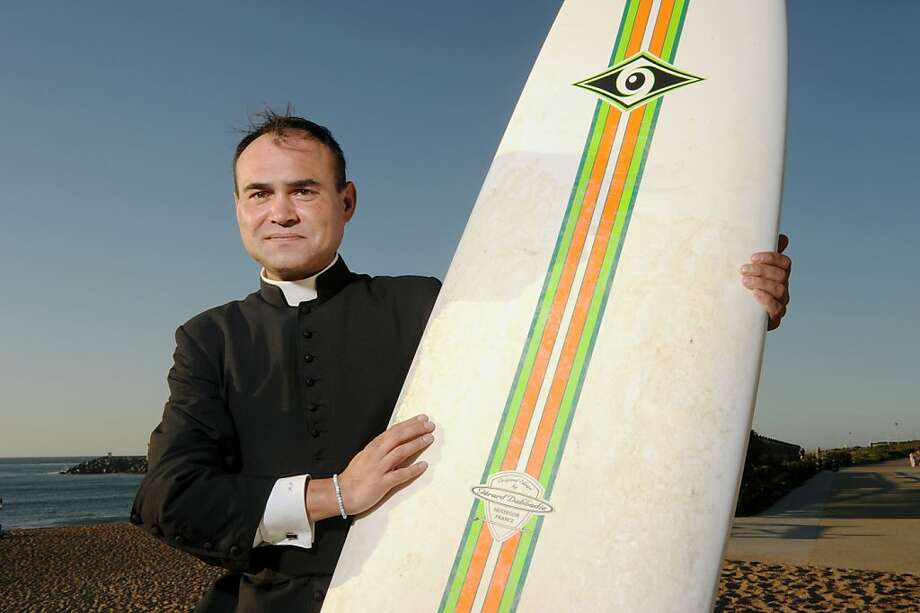 They also serve the Lord who only stand on waves: French Catholic priest and surfing enthusiast Rene-Sebastien Fournie might be praying for an on-shore breeze at Plage des Cavaliers in Anglet, France. Photo: Gaizka Iroz, AFP/Getty Images