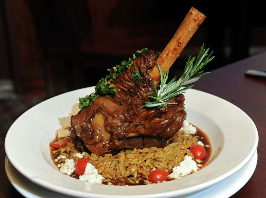 Slow roasting Cassel Farms lamb shank with toasted orzo, grape tomatoes and Maplebrook Farm feta natural lamb gravy at Jack Dillon's restaurant on Friday, Sept. 20, 2013 in Saratoga Springs, N.Y.  (Lori Van Buren / Times Union) Photo: Lori Van Buren / 00023932A