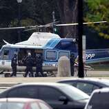 A U.S. Park Police helicopter is loaded on the Mall in Washington, Thursday, Oct. 3, 2013, with a victim from a shooting. Police say the U.S. Capitol has been put on a security lockdown amid reports of possible shots fired outside the building.
