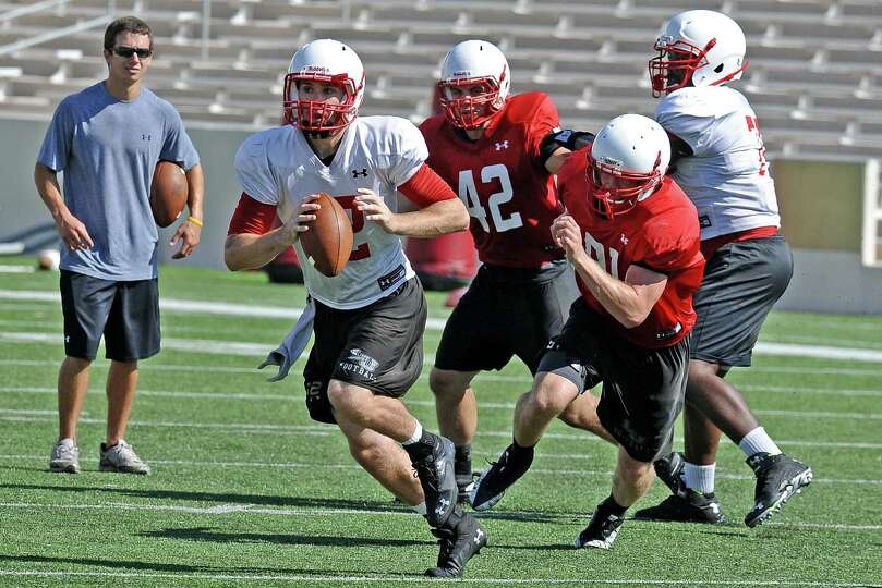 Quarterback Caleb Berry (No. 12) runs with the ball during the Lamar University football scrimmage o