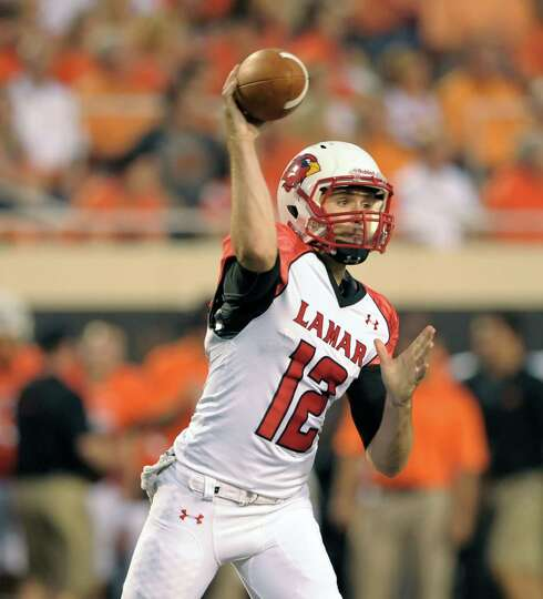 Lamar quarterback Caleb Berry throws a pass down field during a game in Stillwater, Okla. Berry had