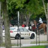 A Secret Service vehicle joins law enforcement officers on horseback from the US Park Police, as they shutdown access n Pennsylvania Ave., directly in front of the White House in Washington, Thursday, Oct. 3, 2013, after a shooting on Capitol Hill.  Police say the U.S. Capitol has been put on a security lockdown amid reports of possible shots fired outside the building. (AP Photo/Pablo Martinez Monsivais)