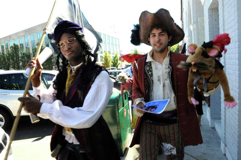 "Akhallid Graham, 20, and John Stegmair, 25, actors of Bridgeport, Conn.'s Downtown Cabaret Children's Theatre, strowl along Greenwich Avenue last month to promote the Oct. 5, 2013, performance of ""How I Became a Pirate"" at the Greenwich Arts Council. Photo: Helen Neafsey / Greenwich Time"