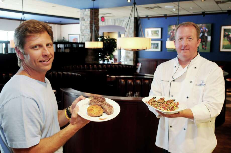 L-R:  Joe Marrello, Restaurant Owner, and James Kavanaugh, Restaurant Executive Chef in the dinning room of the new Jacob & Anthony's American Grille on Thursday, July 8, 2010, on High Rock Rd. in downtown Saratoga Springs, NY.  The new grille is the restaurant at 38 High Rock, a high end condo project that offers retail, office & this restaurant space as amenities for the housing units upstairs.   Photos for new Saratoga Style, 2010 for centerpiece map featuring new Biz. Photo: LUANNE M. FERRIS, TIMES UNION / 00009438A