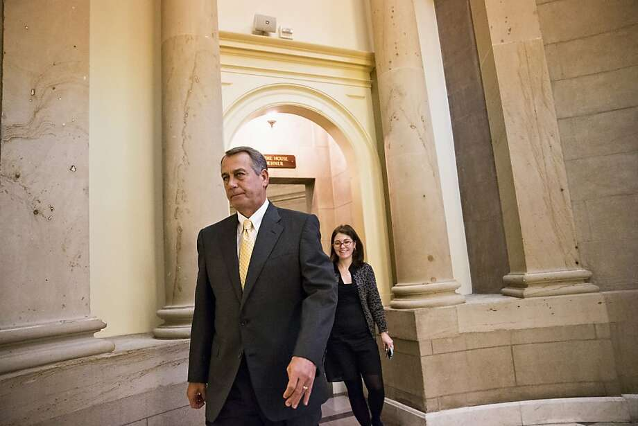 House Speaker John Boehner is getting pressure from the president, Republican conservatives and outside Tea Party groups. Photo: J. Scott Applewhite, Associated Press