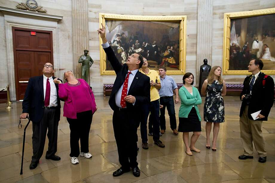 Sen. John Boozman, R-Ark., leads a tour in the Rotunda on Capitol Hill in Washington,Thursday, Oct. 3, 2013. Congressional staffers and interns usually lead constituent tours, but due to the federal government shutdown members of Congress have begun to lead tour groups from their home states.  (AP Photo/ Evan Vucci) Photo: Evan Vucci, Associated Press