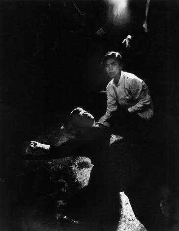 CALIFORNIA, UNITED STATES - JUNE 05:  Senator Robert Kennedy sprawled semiconscious in his own blood on floor after being shot in the brain & neck while busboy Juan Romero tries to comfort him, in kitchen at hot