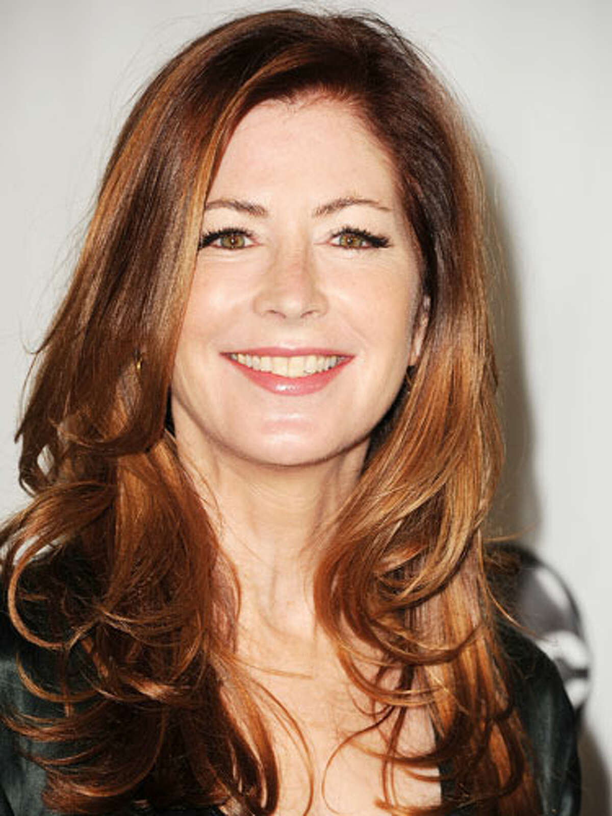 Dana Delany's Gentle Curls Dana Delany rocks gentle curls with a red glow. Her long, side-swept layers and bounce give her look a youthful feel. Born with straight hair? Take a 2-inch curling iron and curl strands away from the face. 16 Celebs Who Look Better With Age10 Biggest Hair Care MythsHaircuts That Take Off 10 Years15 Slimming Superfoods To Try in 201310 Ways To Build Your Sexual Confidence