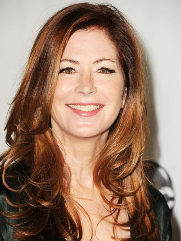 Dana Delany's Gentle CurlsDana Delany rocks gentle curls with a red glow. Her long, side-swept layers and bounce give her look a youthful feel. Born with straight hair? Take a 2-inch curling iron and curl strands away from the face.