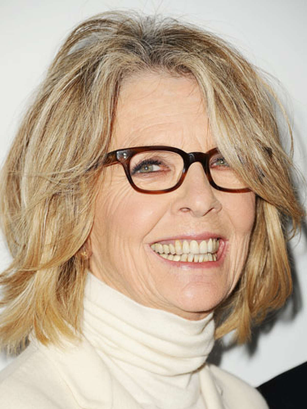 Diane Keaton's Layered Bob Lots of flirty layers keep Keaton's style fresh and full of movement; face-framing fringe also offers a fun complement to her bold specs. Ask for a layered bob that falls just below the jaw line and includes shorter fringes around the face and side-swept bangs. To style, use a round brush to flip ends out as you blow dry. 16 Celebs Who Look Better With Age10 Biggest Hair Care MythsHaircuts That Take Off 10 Years15 Slimming Superfoods To Try in 201310 Ways To Build Your Sexual Confidence