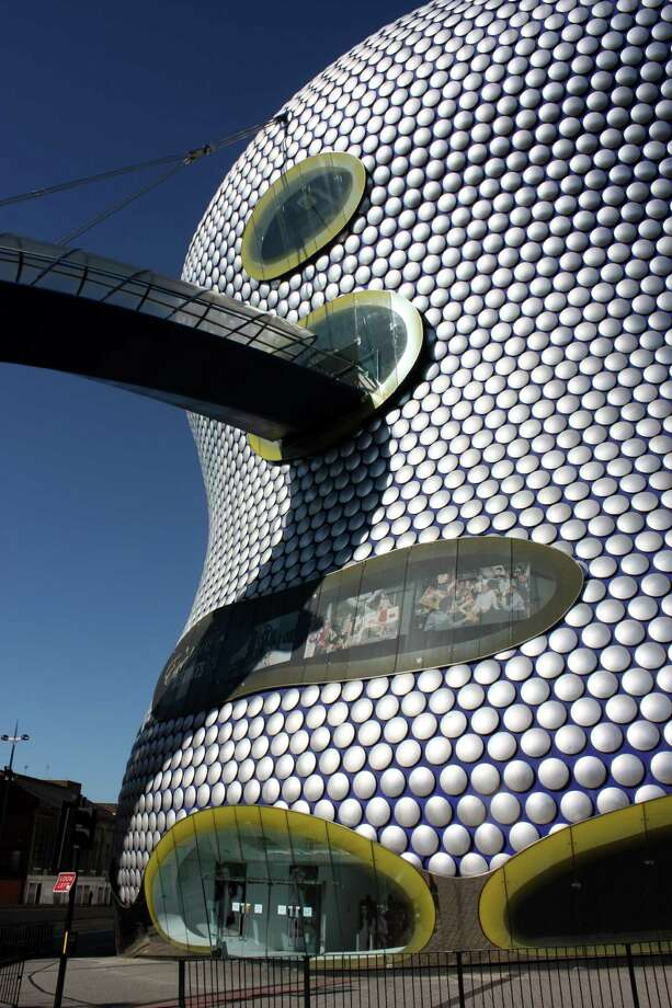 """Selfridges Building, in Birmingham England, designed by Future Systems and built in 2003. Emporis writes: """"A shopping center, the Selfridges Building is completely clad in 60 cm (24 inch)-wide, shimmering pieces of aluminum. The idea of a 'cave-like' shopping universe was the starting-point for the building's futuristic design."""" Photo: Neil Nickolds"""