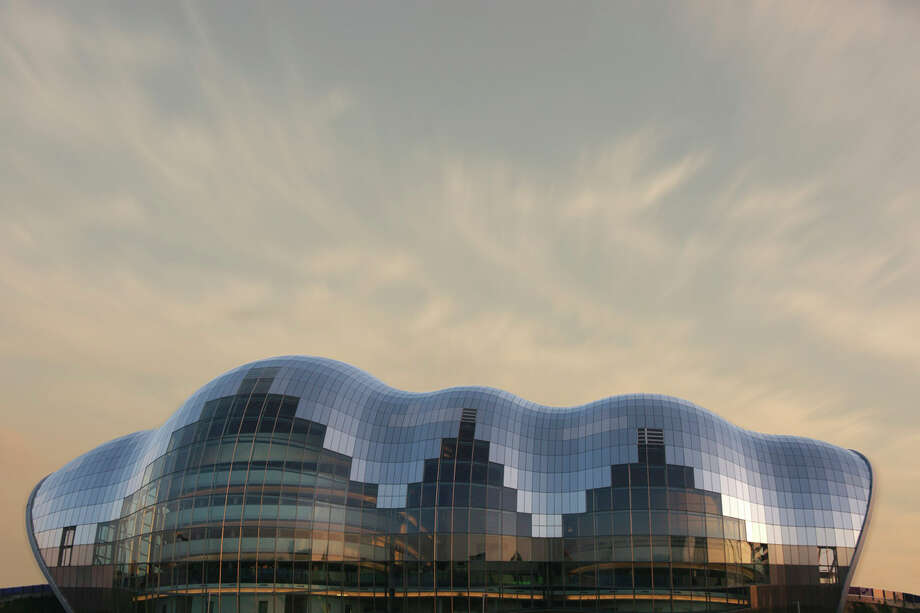 "The Sage Gateshead, in Gateshead, England, designed by Foster + Partners and built in 2004. Emporis writes: ""Under its curved glass mantle, The Sage Gateshead houses three concert halls of varying size, all equipped with high-end technology."" Photo: Ian Britton, FreeFoto.com / freefoto.com"