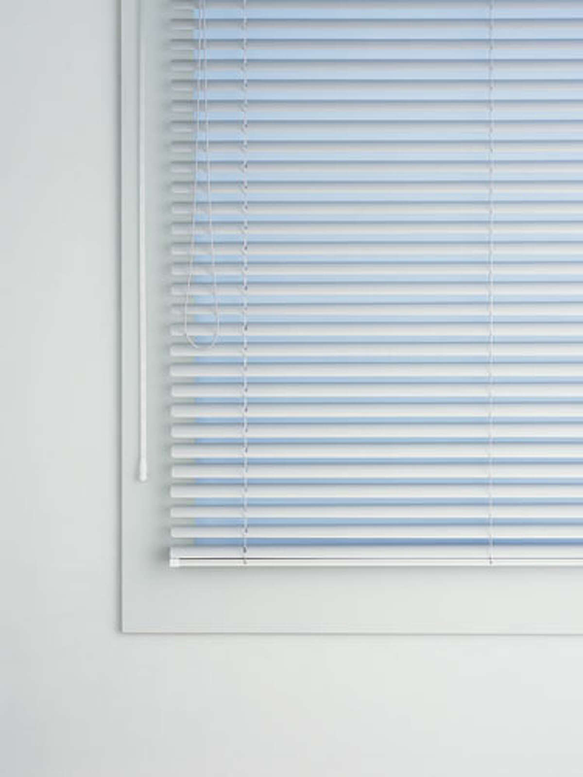 Blinds The material they're made of - metal, wood, or fabric - determines how you dust them. For metal blinds, wipe with a sock lightly dampened with water or multi-purpose cleaner. For wood blinds follow the same procedure using only a little tap water. Do not overwet the wood and be sure to buff dry right away. For fabric blinds, go over the blinds with a dry microfiber cloth. 34 Double-Duty Home Items52 Easy Home-Organizing Tips10 Biggest Organizing MistakesHaircuts That Take Off 10 Years10 Ways to Boost Your Sexual Confidence