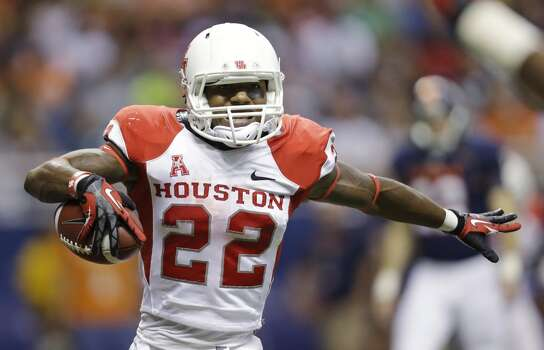 Sept. 28: Houston 59, UTSA 28Record: 4-0  Houston's Ryan Jackson (22) celebrates a touchdown during the first half of an NCAA college football game against Texas-San Antonio, Saturday, Sept. 28, 2013, in San Antonio. (AP Photo/Eric Gay) Photo: Eric Gay, Associated Press