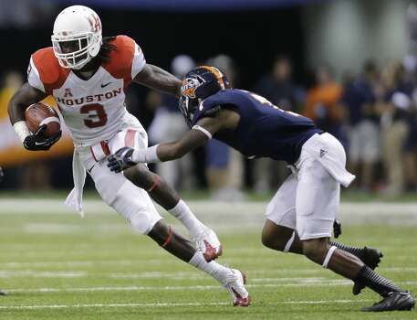 Houston's Deontay Greenberry (3) tries to avoid Texas San Antonio's Triston Wade (7) after making a catch for a first down during the first half of an NCAA college football game on Saturday, Sept. 28, 2013, in San Antonio. (AP Photo/Eric Gay) Photo: Eric Gay, Associated Press