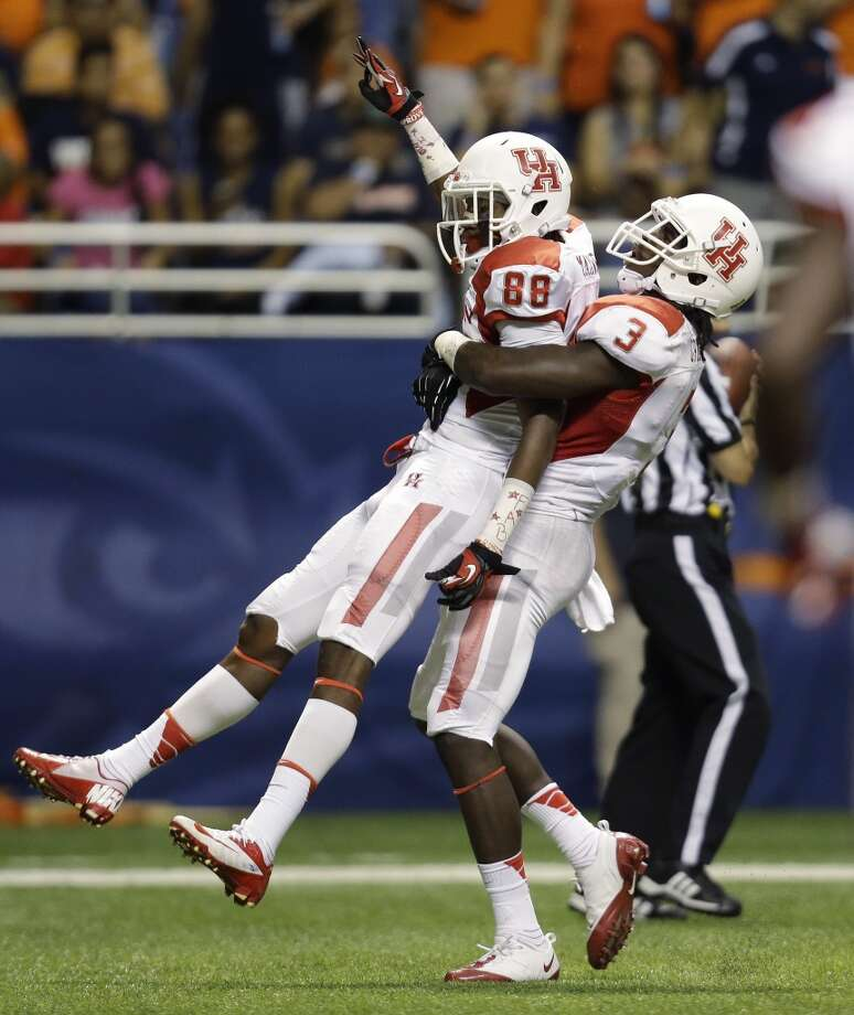 Houston's Xavier Maxwell (88) is lifted by teammate Deontay Greenberry (3) as they celebrates Maxwell's touchdown catch during the first half of an NCAA college football game against Texas-San Antonio, Saturday,  Sept. 28, 2013, in San Antonio. (AP Photo/Eric Gay) Photo: Eric Gay, Associated Press