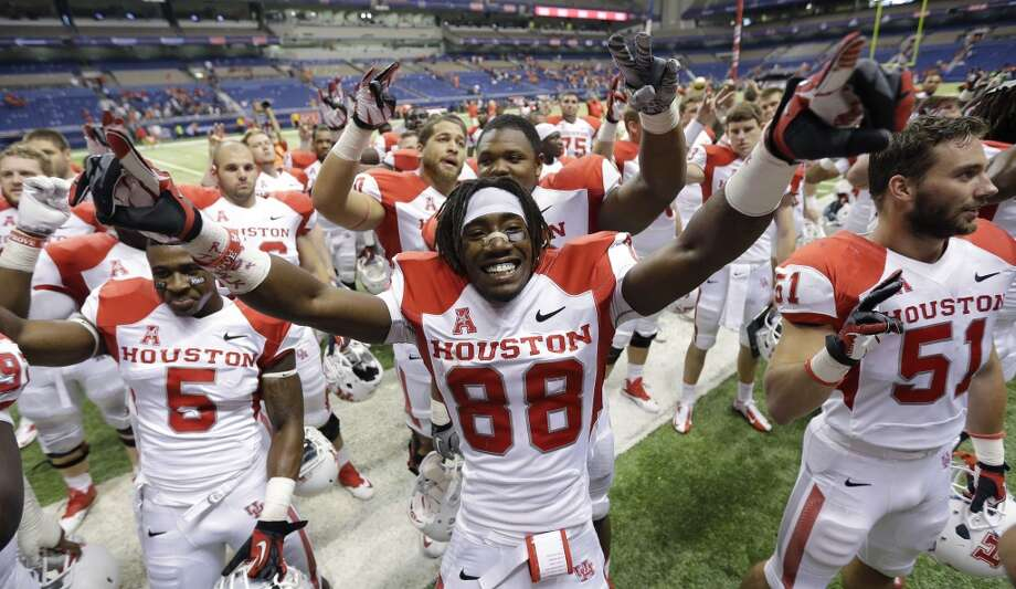 Houston's Xavier Maxwell, center, celebrates with teammates after defeating Texas-San Antonio in an NCAA college football game, Saturday, Sept. 28, 2013, in San Antonio. Houston won 59-28. (AP Photo/Eric Gay) Photo: Eric Gay, Associated Press