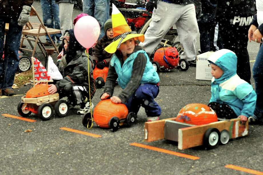 Gabby Jimenez, 7, of Newtown, checks out her competition at the start of the Great Pumpkin Race in Newtown on Saturday, Oct. 29, 2011. The year's Great Pumpkin Race will be Saturday, Oct. 19, behind Edmond Town Hall. Photo: Michael Duffy