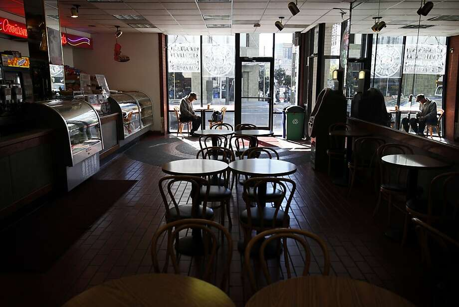 Elmer Wynn sits in Gateway Croissants on Larkin Street, where restaurant business is slow with federal workers on furlough. Photo: Sarah Rice, Special To The Chronicle