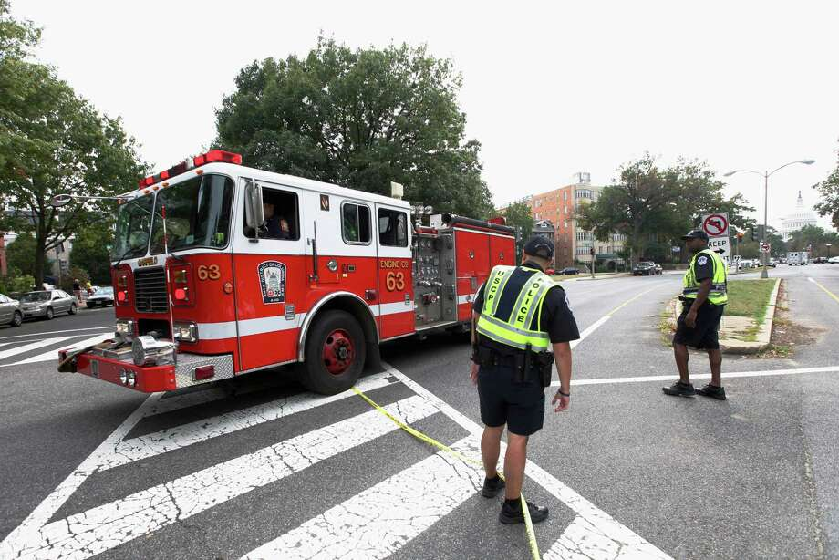 A fire truck leaves the scene of a shooting on Capitol Hill in Washington, Thursday, Oct. 3, 2013. A police officer was reported injured after gunshots at the U.S. Capitol, police said Thursday. They locked down the entire complex, at least temporarily derailing debate over how to end a government shutdown. Photo: AP