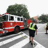 A fire truck leaves the scene of a shooting on Capitol Hill in Washington, Thursday, Oct. 3, 2013. A police officer was reported injured after gunshots at the U.S. Capitol, police said Thursday. They locked down the entire complex, at least temporarily derailing debate over how to end a government shutdown.