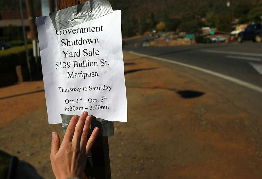 Furloughed Yosemite worker Marielle Debree advertises a yard sale she and her husband are holding to raise money. Photo: Leah Millis, The Chronicle