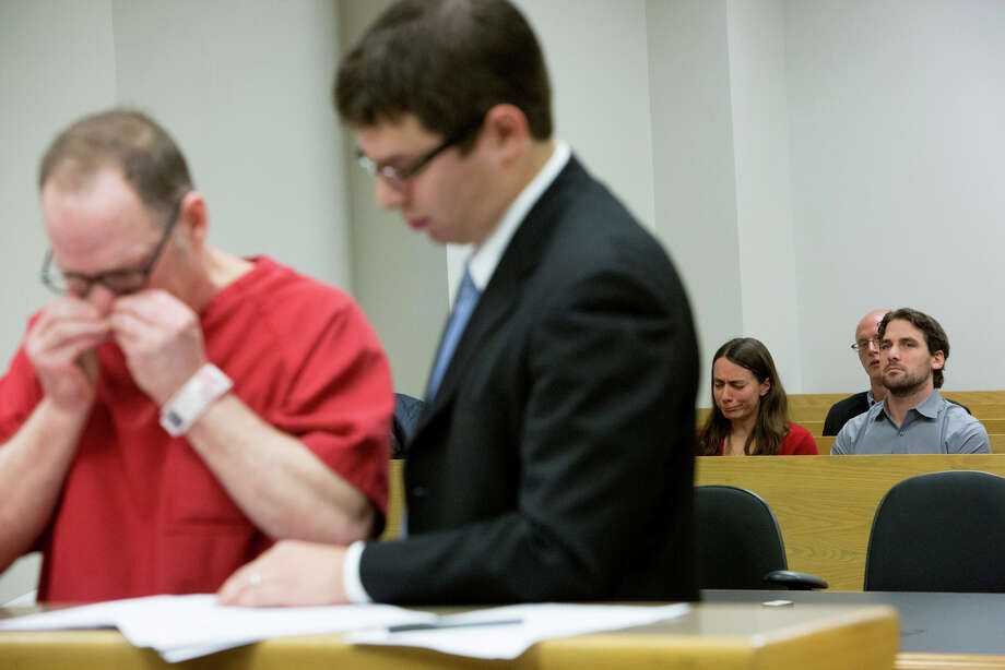 Dan and Marilyn Schulte, background, react as Mark Mullan, left, pleads guilty to charges after killing their parents Judy and Dennis Schulte and seriously injuring Dan's wife Karina Ulriksen-Schulte and newborn baby Elias Schulte. Photo: JOSHUA TRUJILLO, SEATTLEPI.COM / SEATTLEPI.COM