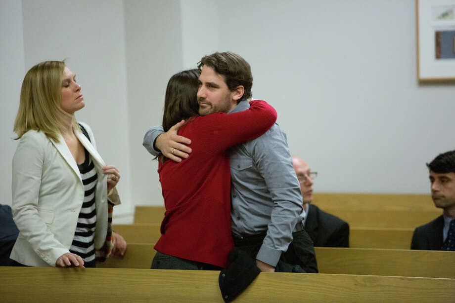 Siblings Dan and Marilyn Schulte hug as Mark Mullan is led away after he pleaded guilty to charges from killing their parents and injuring Dan's wife and newborn son. Photo: JOSHUA TRUJILLO, SEATTLEPI.COM / SEATTLEPI.COM