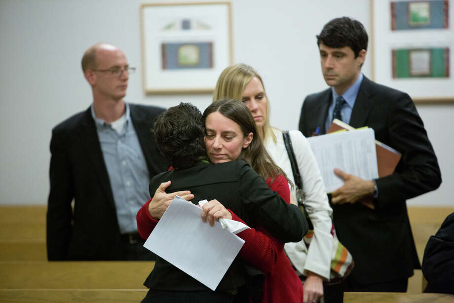 Marilyn Schulte hugs a prosecuting attorney as Mark Mullan is led away. Photo: JOSHUA TRUJILLO, SEATTLEPI.COM / SEATTLEPI.COM