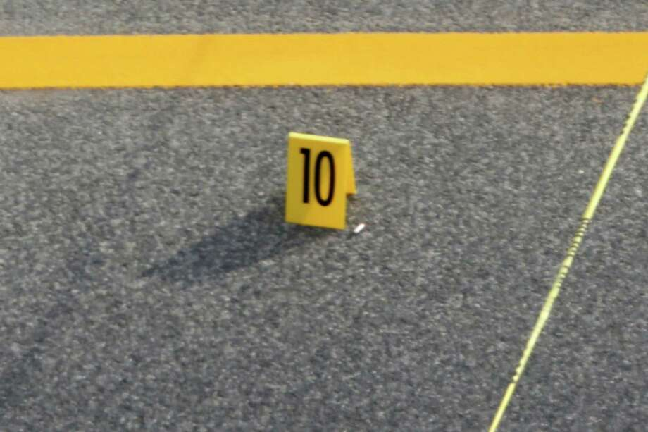 An evidence marker is placed not far from a car following a shooting on Capitol Hill in Washington, Thursday, Oct. 3, 2013. A police officer was reported injured after gunshots at the U.S. Capitol, police said Thursday. They locked down the entire complex, at least temporarily derailing debate over how to end a government shutdown. Photo: AP