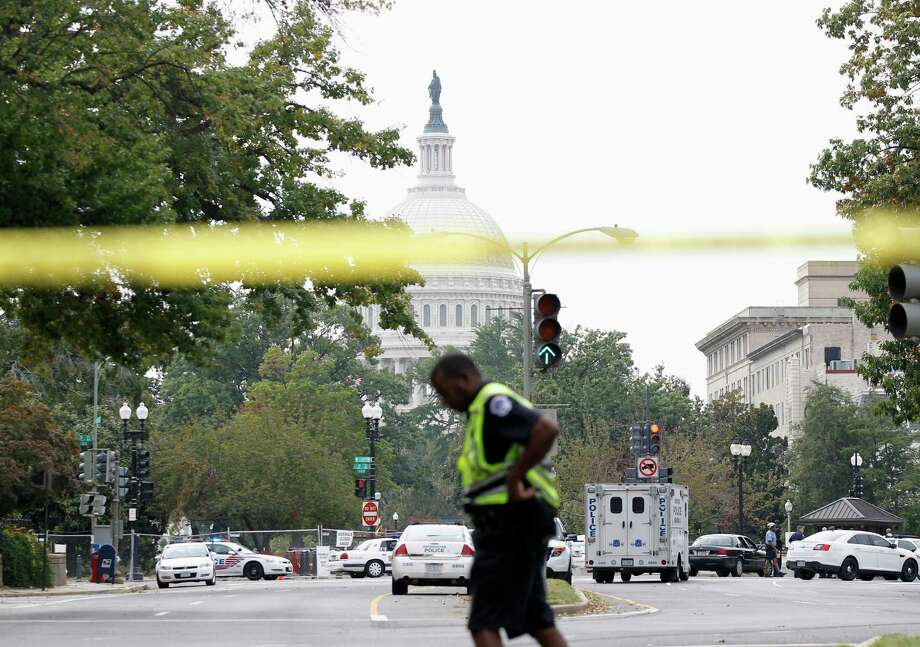 Police respond to a shooting on Capitol Hill in Washington, Thursday, Oct. 3, 2013. A police officer was reported injured after gunshots at the U.S. Capitol, police said Thursday. They locked down the entire complex, at least temporarily derailing debate over how to end a government shutdown. Photo: AP