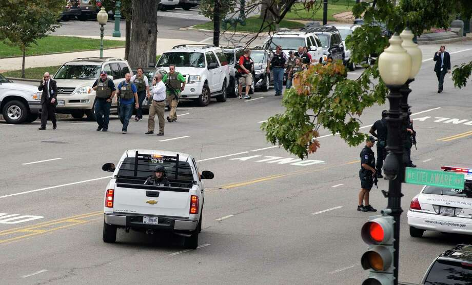Police and federal agents converge on the scene of a shooting on Constitution Avenue on the campus of the U.S. Capitol and near the Supreme Court, in Washington, Thursday, Oct. 3, 2013. The view is of Constitution and Delaware Ave., as seen from the Russell Senate Office Building. Photo: AP